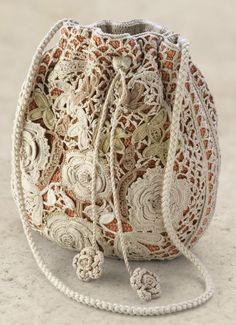 Lace-beautiful.  Use old tables cloths or pieces of lace.
