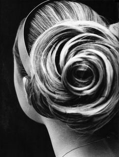 Hair by Odile Gilbert. A camelia hair bun backstage at the Spring-Summer 2000 Chanel Haute Couture show, photographed by Capella.