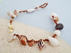 Handmade using durable weather-resistant brown waxed fiber. Macrame loop and puka shell Seashell Jewelry, Seashell Necklace, Seashell Crafts, Shell Necklaces, Beach Jewelry, Glass Jewelry, Feet Jewelry, Shell Schmuck, Diy Schmuck