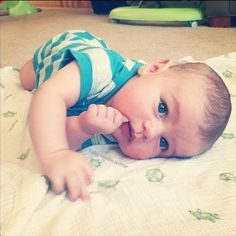 Adorable baby boy with beautiful blue eyes
