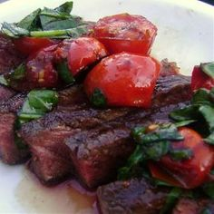 Balsamic Rib Eye olive oil for brushing grill 3 tbsp balsamic vinegar 1 1/2 tbsp brown sugar 2 tbsp soy sauce salt and pepper to taste 10 cherry tomatoes 1 small bunch basil, chopped Whisk together the balsamic vinegar, brown sugar, soy sauce, salt and pepper to taste. Pour into an airtight container or zip plastic bag. Place steak in container or bag, making sure it is completely immersed. Seal/cover and marinate in refrigerator for at least 30 minutes or as long as overnight.