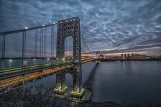 The George Washington Bridge seen at sunrise from the Fort Lee Historic Park in January of Photo by Kris Denkers/Gypsy Owl Photography Manhattan, Intelligent Transportation System, Fort Lee, Washington Heights, City Wallpaper, Hudson River, George Washington Bridge, City Lights, New Jersey
