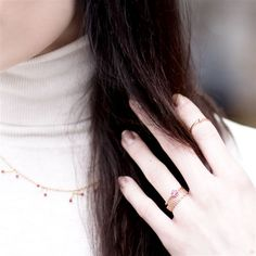 Cats & Dogs admits she is far from getting engaged, but she still can't resist the dainty rose gold engagement ring on her index finger. See the other jewels she tries on at Temur in Berlin here and find the boutique in our shopping guide. Photo: Cats & Dogs