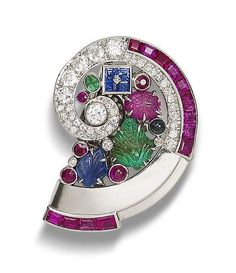 A multi-gem set clip brooch, by Mauboussin The conchoidal brooch set with carved and faceted rubies, emeralds, sapphires and diamonds,diamonds approximately 1.50 carats total, length 4.0cm