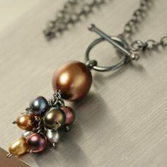 Rustic wire wrapped freshwater pearl, sterling silver necklace. $89.95