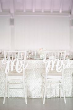 Signage for the sweethearts: http://www.stylemepretty.com/2015/09/07/all-white-wedding-details-we-love/: