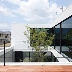 House with a hair salon hidden at the back by Apollo Architects & Associates