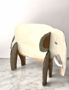 DIY Cardboard elephant made from recycled boxes!  Easy to use templates!