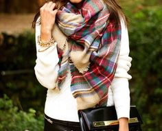 This stunning oversized luxurious plaid blanket scarf will surely keep you warm this season. Layer with any look, you'll want to wear this everyday.