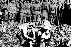 Chinese prisoners are buried alive by Japanese soldiers.