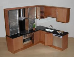 Playscale kitchen in cherry and steel    With doors and drawers in solid cherry, this kitchen has an underslung sink, built-in dishwasher and sensor hob or stove top.
