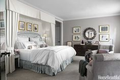 In the master bedroom of a Los Angeles house, taupe and lavender harmonize with an ivory bed-curtain treatment of crisply pleated Shabby Lin Délavé linen by Pierre Frey.