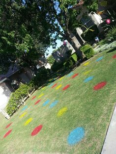 RAINBOW PARTY BY CHRISTINE LOLLAR-cut a circle in cardboard (trace large bowl for perfect circle), tape newspaper or garbage bags to sides if cardboard, spray paint...imagine announcing boy or girl with pink dots; hang streamers from trees, flowers from filament #yard decor #kid party #grass #paint #shower #rainbow #twister #outside decor #polka dots #birthday #preteen #party