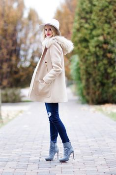 Emily Jackson is wearing a blush pink Chateau parka from J. Crew