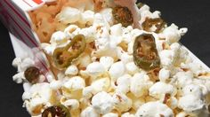 Freshly-popped popcorn is tossed with melted butter, ranch dressing mix, and crispy jalapenos for an addictive snack with a hint of heat.