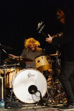 Drummer Taylor Hawkins of Foo Fighters onstage at the Sound City debut at Sundance Film -- hair flying behind his Gretsch drumset-- on January 18, 2013 in Park City, Utah. #DdO:) - https://www.pinterest.com/DianaDeeOsborne/drums-drumming-joy/ - DRUMS AND DRUMMING JOY. Great action concert photo by Jason Merritt, pinned with description's basics via Janie241's MAGNIFICENT #DRUMS #Pinterest board.