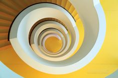 Going in circles - A unique yellow spiral staircase at Bibliothèque Universitaire de Chevreul in Universite Lyon 2 Lumière.   I uploaded this photo earlier, but because of a problem with the resolution and size I removed it again.  Luckely I had seen some cool and inspirational photo's of these stairs, because most of the time I was in Lyon the weather was bad. Few nice cityscapes were possible. This staircase however was a interesting challenge. I couldn't go al the way up, because the top…