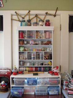 Store ribbon and fabric trim on a rod. If your craft involves ribbon, fabric trim or something similar, this simple storage solution helps you avoid knotted messes. A dowel rod that's slotted into a base is all it takes. by Cozy Little House