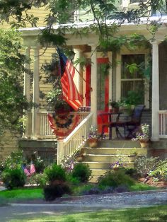 'House With Bunting And Flag': Fine Art Prints by Susan Savad - This suburban house is dressed in its patriotic best in both bunting and an American flag, all ready for the 4th of July. #flag #americanflag #patriotic #patriotism  AS LOW AS $37