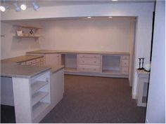 an awesome sewing studio with lots of open space and big huge tables