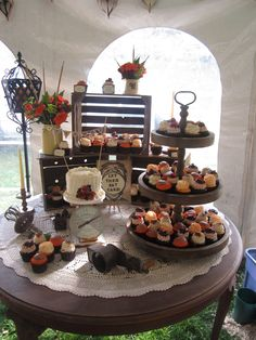 Rustic Wedding Dessert Display French Macarons, Wedding Cake, Dessert Bar Macarons, Truffles & More! Wedding Cake Display, Wedding Cake Photos, Cupcake Display, Dessert Buffet, Dessert Bars, Dessert Tables, Flavor Cupcakery, Rustic Wedding Desserts, Cupcake Bakery