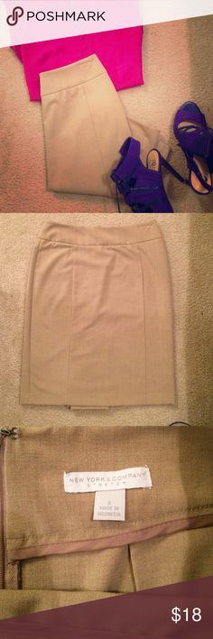 "New York&Co. Skirt New York&Co. • size:2 • tan/khaki pencil Skirt• zipper in back• closed slit in back•22"" length x 30""inseam x 36"" hip• worn once like new new york& co.  Skirts Pencil"