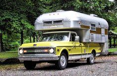 A pristine 1968 Silver Streak truck camper mounted in the bed of an original 1969 Chevrolet Longhorn Custom Camper.