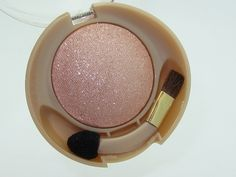 MILANI RUNWAY EYES EYESHADOW in 'Peaches&Cream'. This amazing  generously -sized shadow is brightening with a highlighting effect without a lot of glimmer. It's a lovely sheer luminous creamy peach/ vanilla/ beige. The curved applicator sponge/ brush makes it very easy to use wet or dry as a shadow, liner, etc. Lots of product and  is  great quality for natural / creative effects..$5.97 at WalMart.
