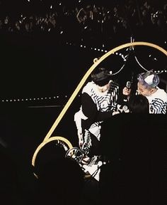 Lay helping Xiumin putting the seatbelt on at the lost planet concert:3 (GIF) #lay #yixing #exo #minseok #xiumin