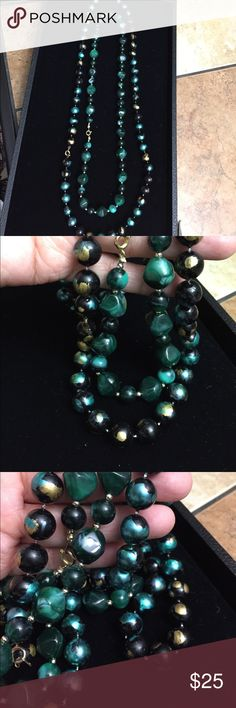 Vintage necklace Beautiful beads one looks like jade and the other one like pearls. One is green and gold the other is just jade color. The woman where I bought it said it was jade. I'm selling both together. Jewelry Necklaces