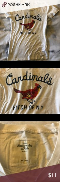 Cardinals tee Worn once #cardinals #baseballtee from #abercrombieandfitch. Super comfy cotton tee with slightly faded word print. No trades please (I will ignore) but feel free to ask any other questions   #baseball #tee #a&f #cardinalsbaseball Abercrombie & Fitch Tops Tees - Short Sleeve