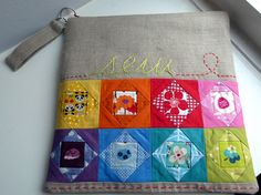 Love the little blocks and the hand stitching. by Laura @ Needles, Pins and Baking Tins, via Flickr