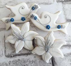 Sneak peek of 25th wedding anniversary cookies. #togetherforever #25yearsstrong #anniversary #celebratelove #kansascitycookier #lilies #anniversarycookies