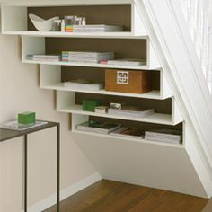 love this idea. Storage/decorating would be so much easier if there were no walls behind stairs!