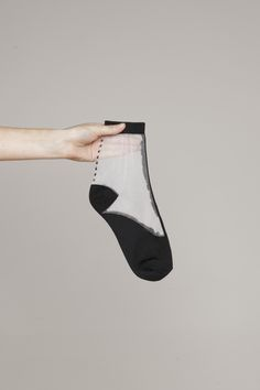 Hansel From Basel collaboration. Crew socks with polkadot sheer detailing and contrasting toe and ribbed ankles. Slips on. Hand wash.