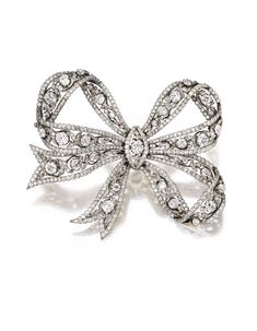 Sotheby's - Platinum, Gold and Diamond Bow Brooch, Circa 1910  Estimate: 30,000 - 50,000 USD  LOT SOLD. 36,250 USD - The delicate three-loop bow of openwork design set with 34 old European-cut diamonds weighing approximately 9.50 carats, accented by numerous smaller old European-cut diamonds weighing approximately 21.25 carats.