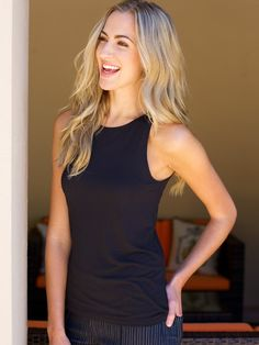 Excursion Tank – Black | Jofit  This easy-to-wear cut away style tank top is made of silken rayon spandex and designed to curve in at the waist to create a complimentary shape.  Match it with our Vortex Slimmer!