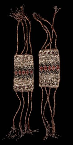 """Solomon Islands ~ Malaita   Pair of arm cuffs """"abegwaro""""   Fine weaving of shell beads, thread on plant fibre cord, natural coloured fond with a diamond-shaped ornament in the centre, dyed in red and black   800€ ~ sold"""