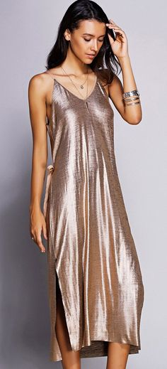 is it a casual summer dress? is it more formal? probably both, and i love it. especially the champagne rose gold color, the sexy yet subtle side slit, and the wrap part in the back. shimmery perfection.