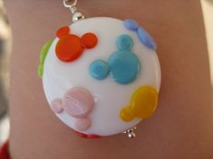 Multicolor Mouse Confetti Sprinkles Icon Sterling Lampwok Glass Bead Mickey Necklace Disney Necklace Pendant Jewelry. $37.00, via Etsy.