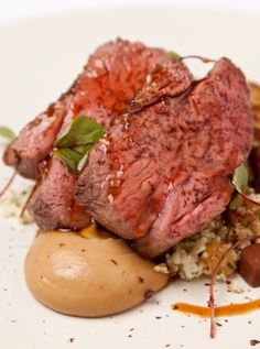 Richard Davies' #WelshLamb is cooked sous vide and served with elegant accompaniments, including a sweep of cauliflower purée, caramelised florets of cauliflower and an unusual chocolate jelly.
