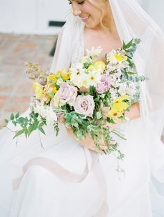 These are our favorite yellow wedding bouquets. Learn more about flowers that typically come in this sunny hue, plus how to use them in your big-day bouquet. Summer Wedding Bouquets, Summer Wedding Colors, Rustic Wedding Flowers, Flower Bouquet Wedding, Flower Bouquets, Summer Weddings, Spring Wedding, Garden Wedding, Yellow Purple Wedding