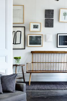 gallery wall and vintage bench