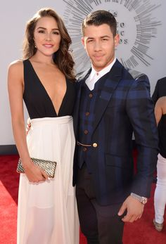 How hot are Nick Jonas and Olivia Culpo together?! Click through to see her best pictures!
