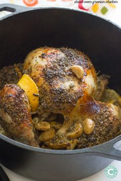 dutch oven grecian chicken- this is the easiest tastiest whole roasted chicken ever!