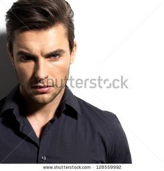 Fashion Portrait Of Young Man In Black Shirt Poses Over Wall With ...