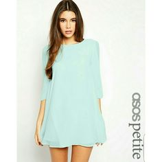 Blue shift dress Light blue shift dress. ASOS petite. US 6. Buttoned back, lined, sleeves that are open from the shoulder to the cuff. The second and third picture are the white version of the dress to show model and fit photos. ASOS Dresses Mini