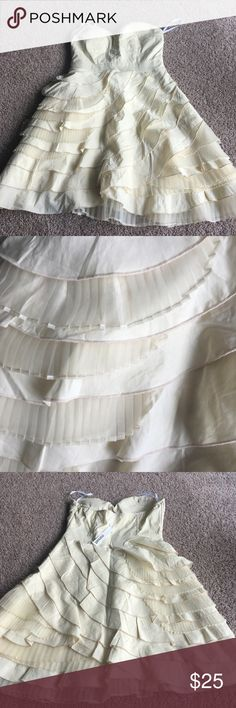 """Cream Strapless Dress Cream colored Strapless dress with a sweat heart neckline. The skirt portion of the dress is made up of different materials and textures to give it sort of a """"shabby chic"""" look. Never worn, new with tags. Dresses Strapless"""