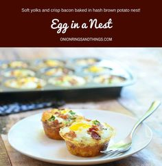 Egg in a Nest with soft yolks, crisp bacon, cheese, and green onions baked in hash brown potato nests. They're a delicious breakfast treat and totally portable for snacking on the go