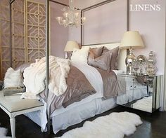 Bliss Linens Lilac Bedroom canopy bed, mirrored nightstands, bench with nailhead trim, ikea pelt, mercury glass lamps and vases, chandelier, lilac walls and espresso stained wood floors.